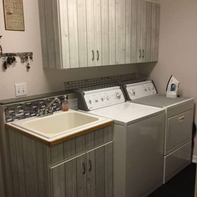 I was done in one day and had a fresh new look for about $40! Now I need to upgrade my laundry tub and faucet... that'll be next :)
