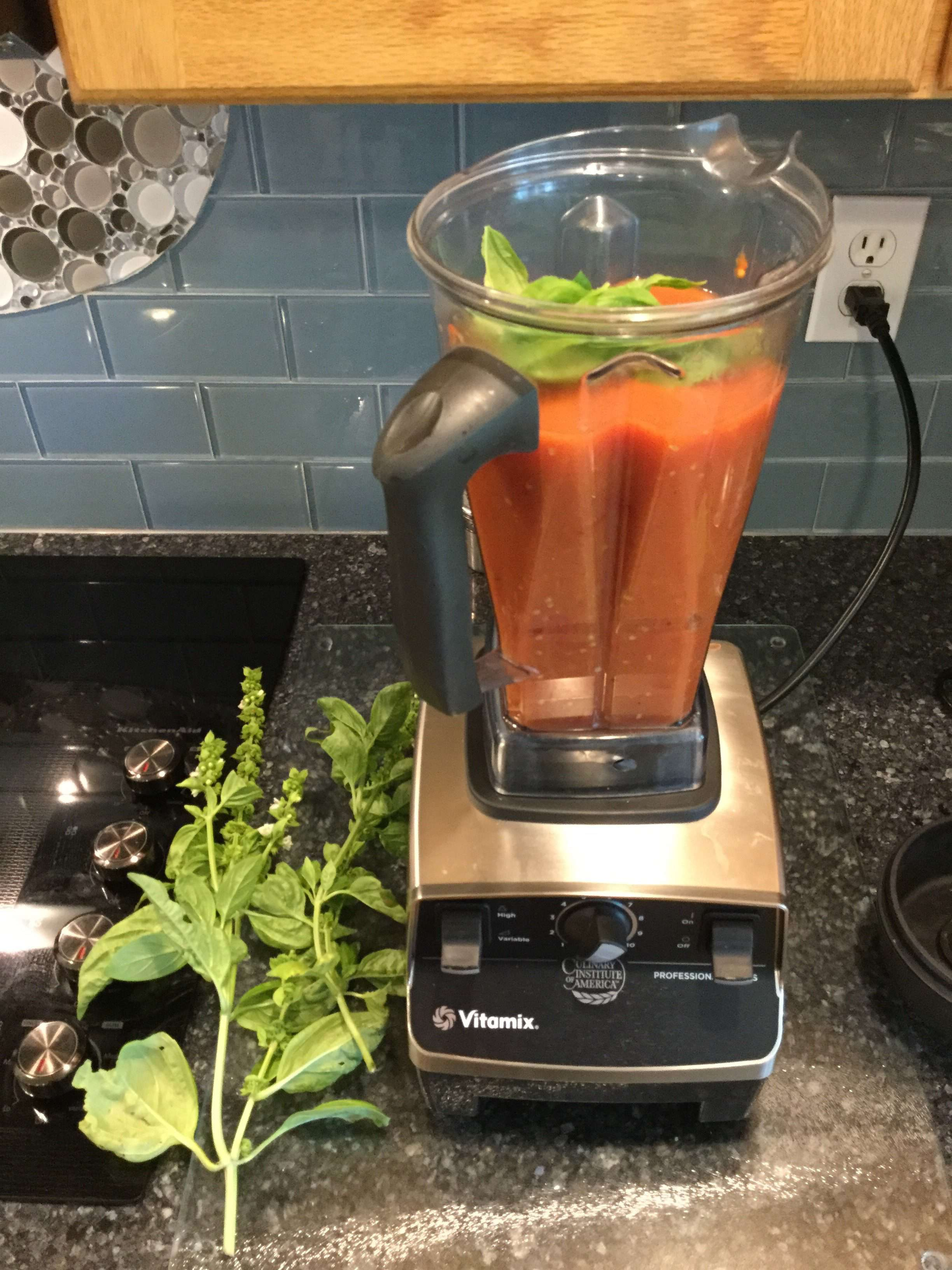 Place the tomatoes in a blender and add fresh basil leaves. Add as many or as few as you like. The more you add, the stronger the basil flavor.