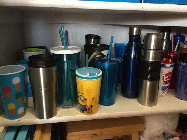 These were our travel cups. They were a mess and were always getting knocked over no matter how many times I tried to organize them.