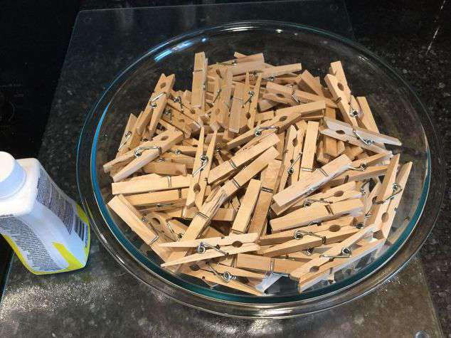 "Put your clothes pins in a large bowl or bucket. *For my wreath it is a 14"" frame from Dollar Tree and it took 156 clothespins."