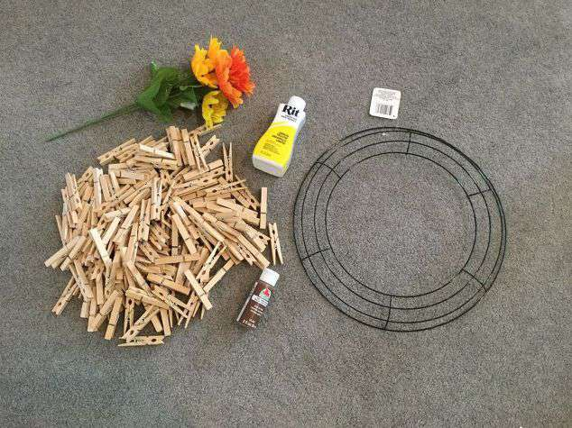 For this project you'll need: Clothespins Rit Dye - I used Lemon Yellow Wreath Form Brown acrylic paint & paint brush Flowers Burlap ribbon Twine Bowl or Bucket for dying