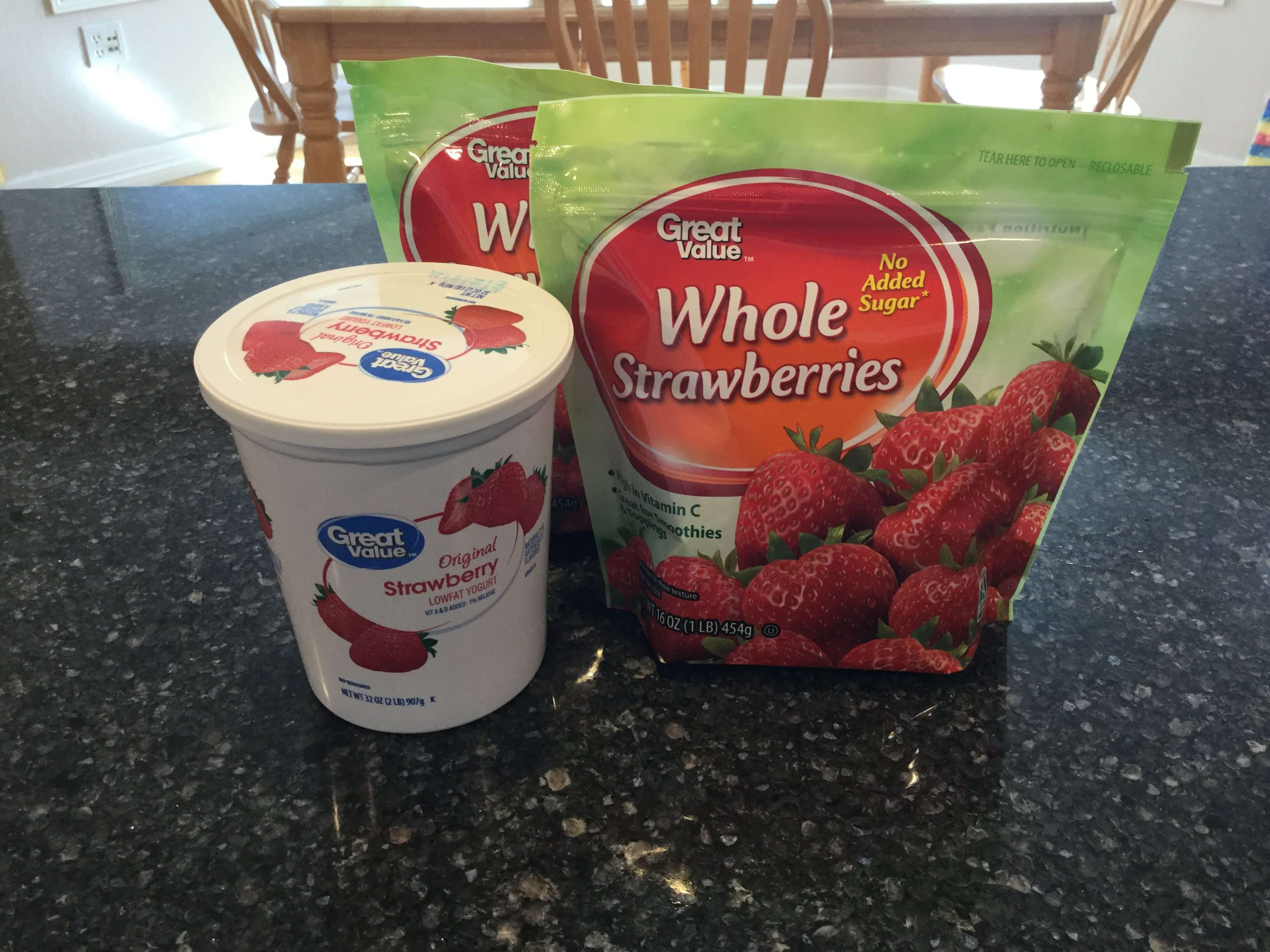 This recipe is adjustable to your own desires and amounts. I use 32 oz. low fat strawberry yogurt & 2 - 16 oz bags unsweetened frozen strawberries (thawed)