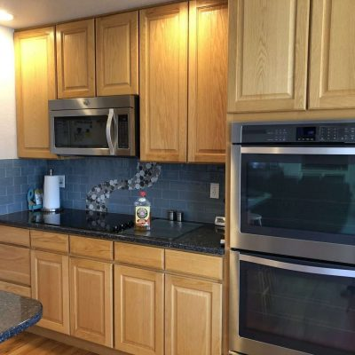Once you have cleaned all of your cabinets, you're done. All the grease, dirt, and grime are gone!