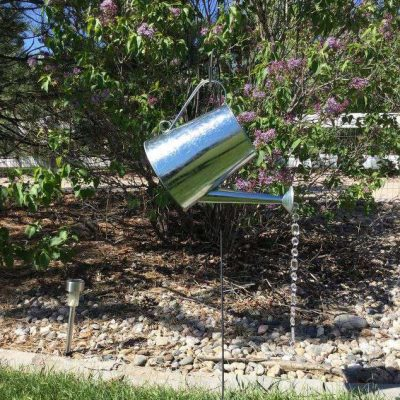 I put my yard stake out in my yard, and simply hung the watering can on it. Stake is 3 feet & the watering can is 8 inches.