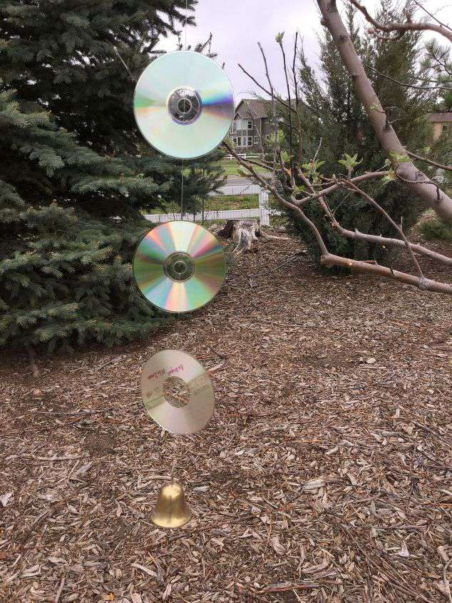 You will need: Used CD's Fish line Bells Large plant s hooks for trees Yard stakes for your garden