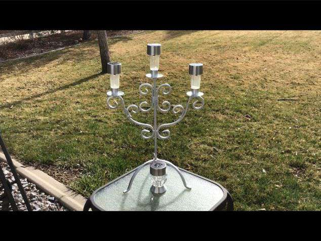 I found this candelabra at a thrift store and with some paint, silicone, and solar lights I changed it into a solarabra.