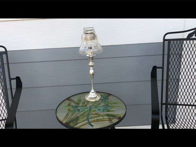 For this first one, the base is a tealight holder that is supposed to have a lampshade. I placed a solar light (minus the stem) into the tealight location and placed an old glass shade over the top.