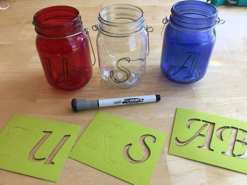 First use your stencils and dry erase marker to write on your letters. You could free hand this if you want.