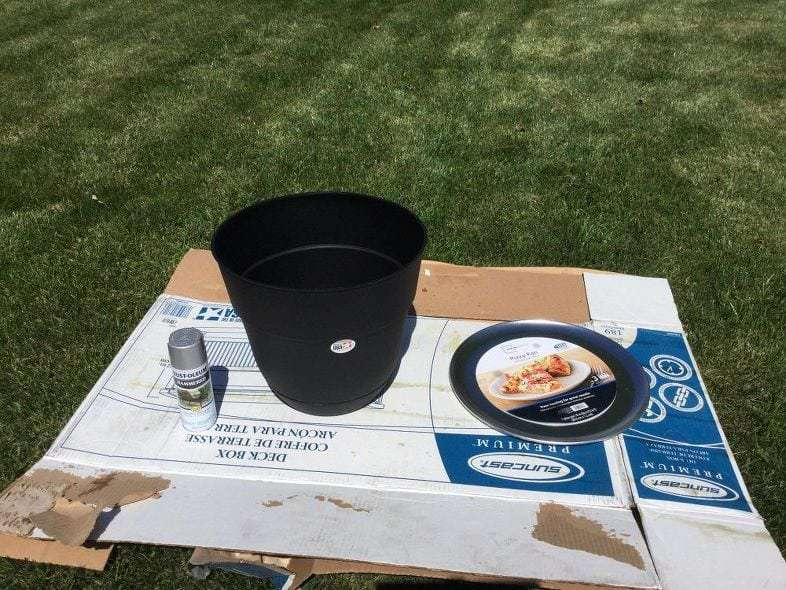 """You'll need a 15"""" plastic flower pot and a pizza pan to create the table. I got both of mine from Walmart."""