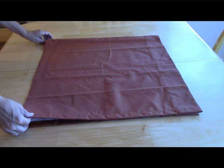 folding cut shower curtain to turn into outdoor pillows