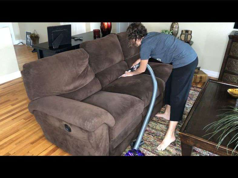 Start by vacuuming your couch. I started by using my crevices tool and this tool gets in all the creases. My friend's couch's cushions were all attached. I went in every crease that couch had. If your cushions are not attached - remove the cushions and get in all the creases all over the couch.