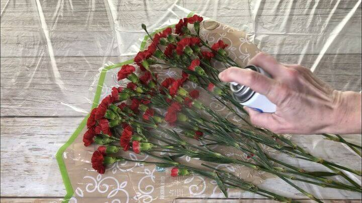 Spray your roses and flowers with hairspray and let them dry out. The hairspray helps them last longer and then as the flowers dry helps preserve them.