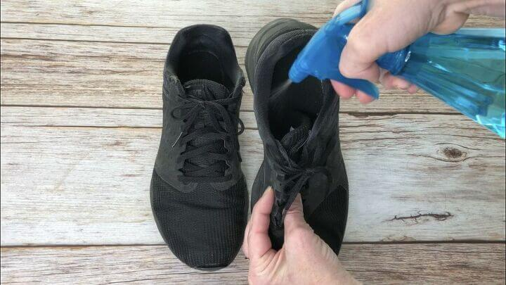 Place rubbing alcohol into a spray bottle. Spray it inside shoes to fight off odors and disinfect them.
