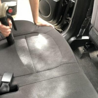 Sprinkle your car seats, floor, back, etc with baking soda. Let sit in the car for 30 minutes and then vacuum it out. This will help neutralize and deodorize your car.