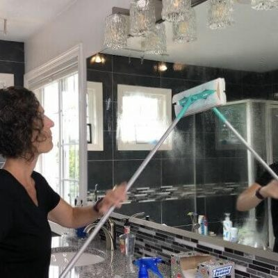 I spray the rubbing alcohol onto the mirror. I then use a Swifter mop with a reusable microfiber cloth and clean my mirrors.