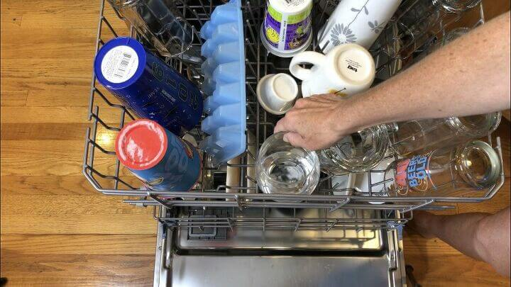 Place it on the top rack. Close and run your dishwasher as usual. Your dishwasher will come out smelling clean and vinegar also acts as a spot remover.