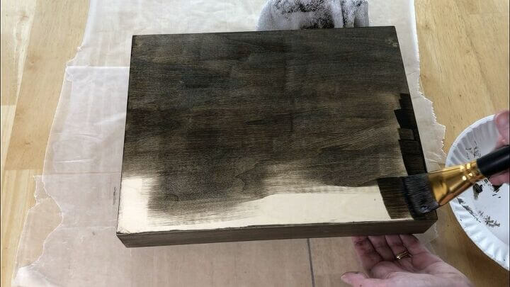 I painted on Folk Art Home Decor Wood Tint in the color Walnut with my Plaid paint brush.