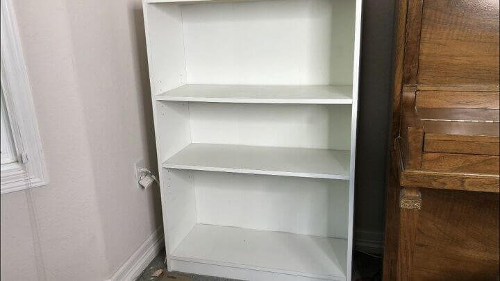 Here is one of my bookshelves, and I felt it was a little plain.