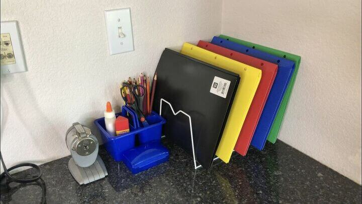 We used a dish rack to homework folders and keep them organized. We also made a portable supply container with colored pencils, glue, and scissors that can be moved out to the table when working and put away when not in use. You can see my daughter using it in the picture above.