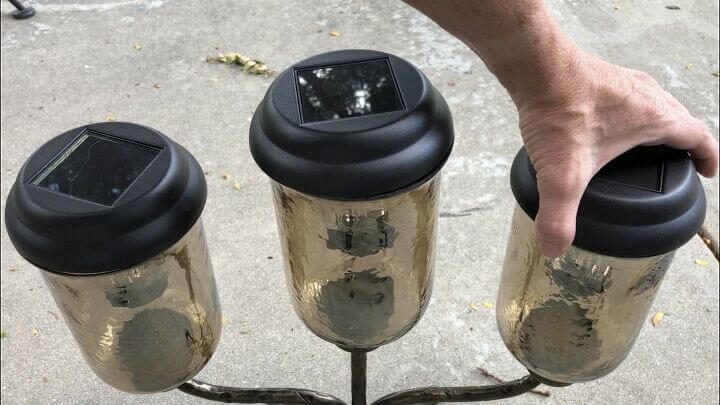 I pulled apart 3 Walmart solar lights from their bases and placed them into the candle holder for a perfect fit.