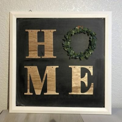 "I love the Target Dollar Section and I found a chalkboard and a ""Home"" garland for just a couple dollars. I turned them into a trendy home sign!"