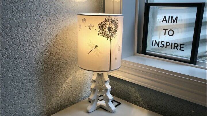 "It's done and I love how it turned out. You could also put the stickers on the inside to create a silhouette. Some lampshades can be a little tricky to get the stickers to ""stick"" too so just add a little Mod Podge under and over the sticker to keep it in place."