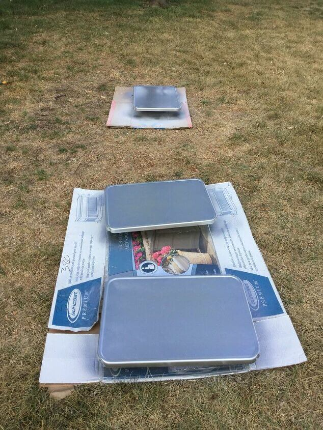 I sanded the tray tops with a sanding block and washed them off. I then spray painted the tray tops with Rustoleum Paint and Primer all in one in the color Titanium Silver. I gave it 3 coats and let it dry between each coat.