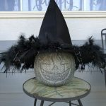 I placed a witch hat on it and put it on display. I think it looks like faux concrete.