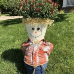 Or I could plant mums in him. I decided to start here and when the mums die, I can put the hat on him.