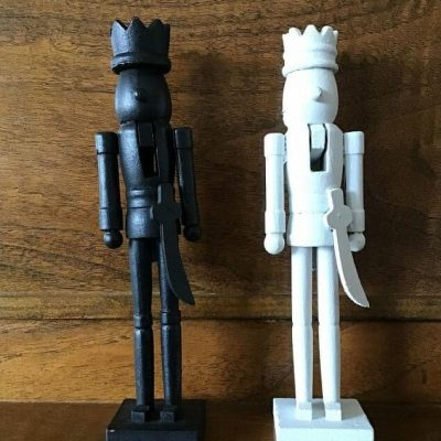 I used Folk Art Home Decor Chalk paint that I had on hand in the colors black and white. I painted each of the Nutcrackers with 2 coats of paint and let them dry between each coat. After the last coat, I let them dry completely.