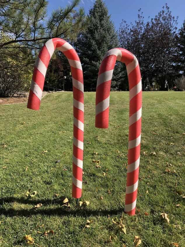 I put some yard stakes into the ground and placed the candy canes onto them.