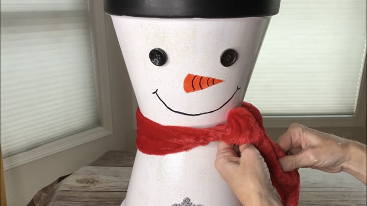 I added a scarf to to his neck. I also added 2 ball solar lights to the top of each Santa and the Snowman.