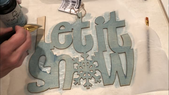 For my let it snow sign, I painted the entire piece with Folk Art Cascade Wood Tint and let that dry.