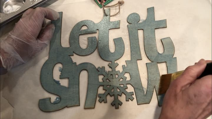 I then painted the entire piece with Folk Art Dragonfly Glaze in the color Blue, Green, Gold Shift. This again left a beautiful shimmer all over the piece giving it that frosty wintery effect.