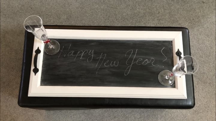 I found 2 cabinet doors at a garage sale for $2. With a little chalk and chalkboard paint I was able to upcycle them into serving trays. Use them as a serving tray, message board, and more - these make great gifts!