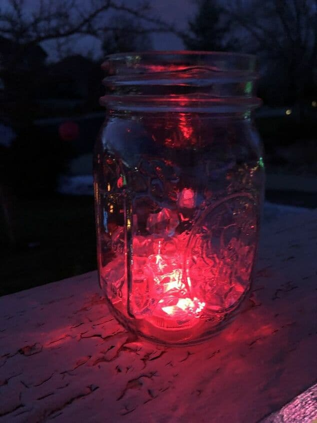 Luminary Recycled Jars - I bought waterproof color changing LED lights with plastic ice crystals at the dollar store. I placed them inside a recycled jar and set them on my railing.