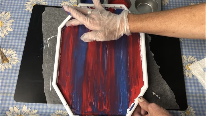 I then hand blended Waverly Chalk Paint in the colors crimson and ocean. I dabbed on some of the paint and smeared it with my hands. You can see this better in the video with this post.