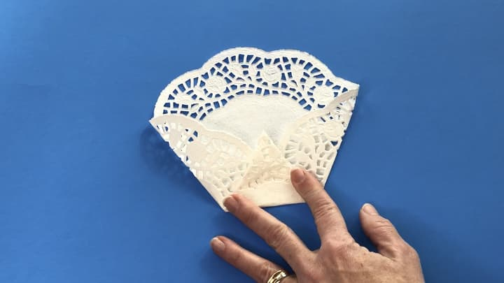 I also bought a couple packages of paper doilies. They were 32 in a pack for all the same size and I used 45 doilies for this project.I folded the 2 sides in to make a point at the bottom and then folded the bottom up to the middle.