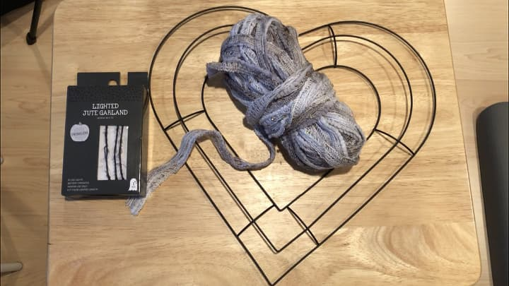 Here are the basic supplies - Heart Wreath Form, Yarn/Fabric, Battery LED Light Strand.