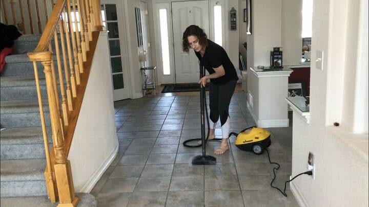 I used the extenders and large cleaning brush and steam cleaned my tile and grout floors. Add the cleaning towel to this attachment and it cleans laminate as well. I used it to clean my wood floor as I have used a steamer in the past with success. You'll want to read the instructions as this steamer is not intended for all surfaces.