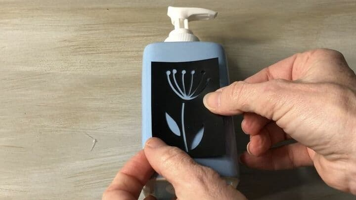 I applied my Folk Art adhesive stencil onto the soap dispenser. Make sure to press firmly so all edges are attached and air bubbles are done.