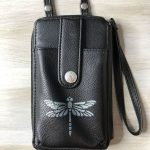 I found a super cute and inexpensive leather wallet at Walmart. I thought it was a little plain so I decided to add a dragonfly to it. Here is how I stenciled on leather and it works for vinyl too.