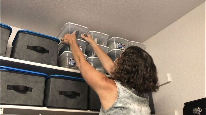 I stack them on my shelf to conserve space, and I can see what is inside the boxes.I have a collapsible stool that I keep in my closet so that I can reach.