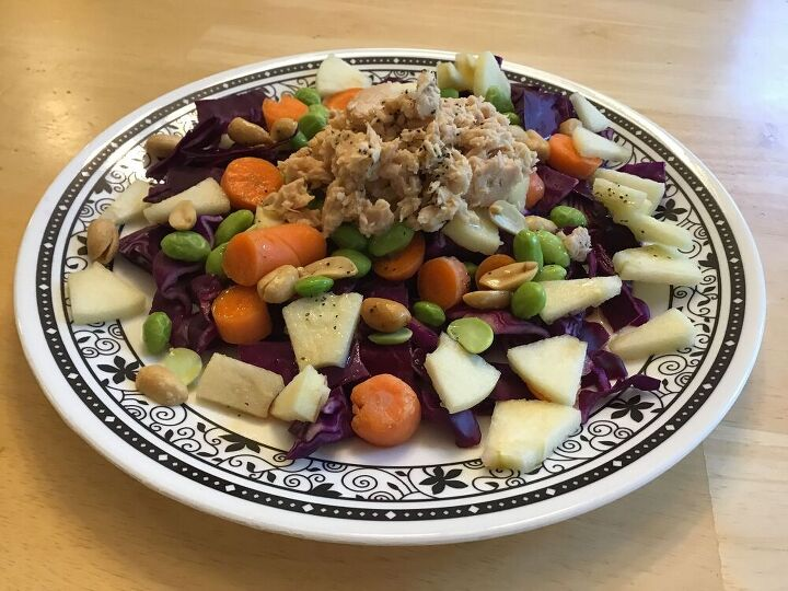 Cut up the cabbage, carrots, and apples to accommodate how many servings you'll need. Place on a plate Add edamame and peanuts Dressing - Mix together vinegar, oil, lime juice, salt, pepper, and ginger Place pouch of wild caught salmon on top of the salad Pour dressing mix on top.