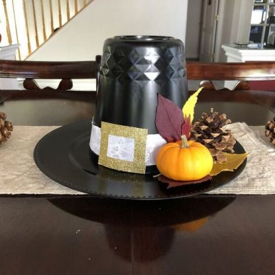 How do you make a simple Thanksgiving centerpiece? How can I decorate my Thanksgiving dinner table? I'm sharing an easy pilgrim hat centerpiece and it only cost me $3.
