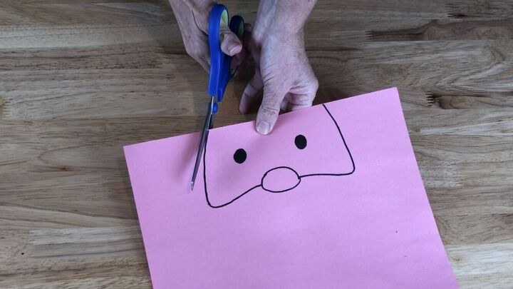 While that was drying I drew a face on pink construction paper and cut it out.