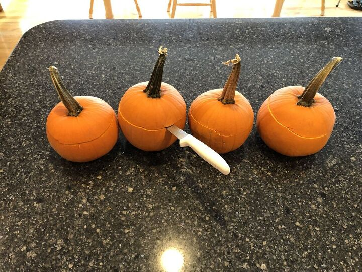 Start by cutting the top off of each pumpkin. You don't need to worry about how straight or how low your cut is.