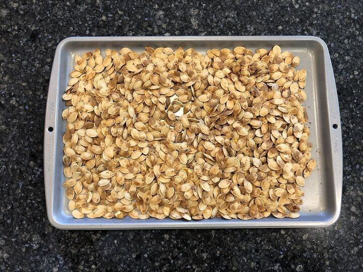 Collect your pumpkin seeds from your pumpkin. Pull out the big chunks or pieces of pumpkin so just the seeds remain Rinse the pumpkin seeds (this is optional) Place seeds in a bowl For every cup of seeds, add 1 TBSP oil, 1 TSP salt, and mix together. Place on a baking sheet Bake at 350 for 45 minutes. Cool and serve