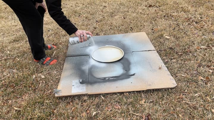 I spray painted the pizza pan with some white spray paint I had on hand from other projects. It was a paint and primer all in one so I was able to cover it in one coat. I let that dry completely before moving on.