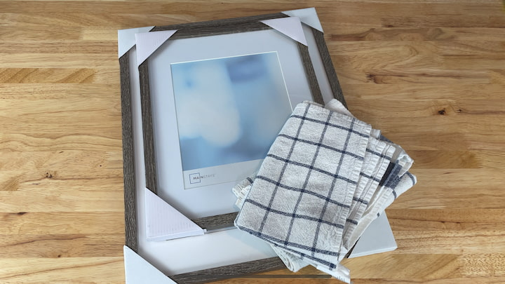 A picture frame Tea towel Plus optional supplies Galvanized word Command Hook Wreath